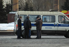 Moscow militia (police). Scenery with typical situation from Moscow life - Moscow policemen (militia) check the documents from three young men, walking on the Royalty Free Stock Photography