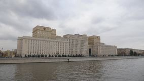 Moscow, Ministry of defence of the Russian Federation. View from the Moscow River across the Frunze Embankment. Camera. In motion. MINISTRY OF DEFENSE, ARMY OF stock video