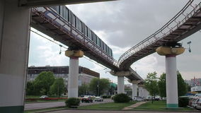The Moscow monorail train in the area of Ostankino TV center. Departs from the station. The view from below. Cloudy stock footage