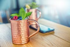 Moscow mule cocktail alcoholic drink on bar counter. Royalty Free Stock Images