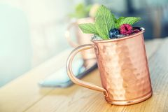 Moscow mule cocktail alcoholic drink on bar counter. Stock Image