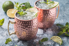 Moscow mule cocktail. In copper cup with lime, ginger beer, vodka and mint garnish Royalty Free Stock Images