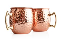 Moscow mule cocktail copper mugs. Isolated on white background Stock Image