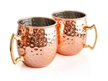Moscow mule cocktail copper mugs. Isolated on white background Stock Images