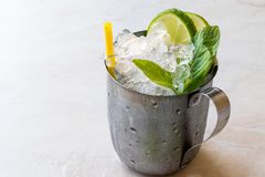 Moscow Mule Cocktail with Lime, Mint Leaves and Crushed Ice in Metal Cup. Summer Beverage stock photography
