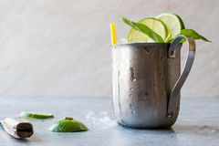 Moscow Mule Cocktail with Lime, Mint Leaves and Crushed Ice in Metal Cup. Summer Beverage royalty free stock image