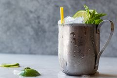 Moscow Mule Cocktail with Lime, Mint Leaves and Crushed Ice in Metal Cup. Summer Beverage stock photos