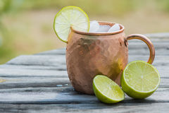 Moscow mule in copper cup with limes Royalty Free Stock Image