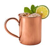 Moscow Mule in a Copper Mug. This is a Vodka drink served with mint, and a garnished with a slice of lime, The image is a cut out, isolated on a white Royalty Free Stock Photo