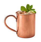 Moscow Mule in a Copper Mug. This is a Vodka drink served with mint, and a garnished with a wedge of lime, The image is a cut out, isolated on a white Royalty Free Stock Images