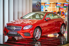 Moscow - 10.04.2017: New Mercedes car at the store with a driver Stock Photography