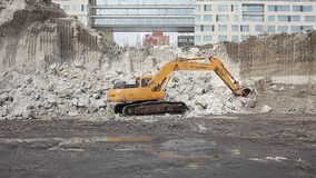 Moscow. News. Today. Snow cleaning spring export. A huge mountain of snow, the loader loads snow into the truck. The municipal aut. Horities of the city are stock video footage