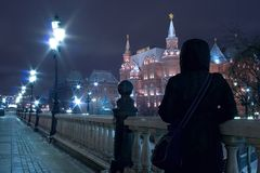Moscow night tourism. Old russian historic place (landmark): Manege square (Manezhnaya ploshchad) in Moscow at a winter evening with view on the State Historical Stock Images