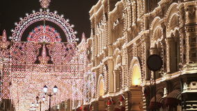 Moscow. Night city decorated with Christmas illumination. The flickering lights of buildings. New Year theme. stock video