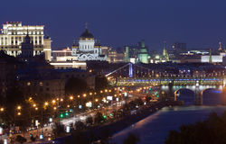 Moscow night view. Night panorama of the Moscow Russia with historical buildings, alighted streets, streetlights, bridges over the Moskva river and dark blue sky Royalty Free Stock Photo