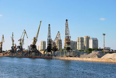 Moscow. Northern river cargo port. Moscow. Cranes in the North river cargo port. Unloading of sand and gravel Royalty Free Stock Image