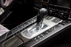 Moscow. November 2018. The shift knob of the full-size luxury car Porsche Panamera Turbo. Carbon panel with logo, shiftgear PDK.  royalty free stock image