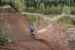 MOSCOW OBLAST, RUSSIA - SEPTEMBER 24 : Motocross, spectacular and extreme sport, off-road racing. Motocross championship Stock Image