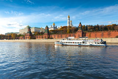 Moscow - October 12: Boat in front of the Moscow K. Touristic boat on Moskva River sails in front of Kremlin royalty free stock image