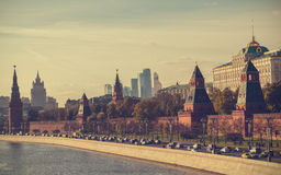 Moscow old and modern architecture. Panoramic view at Kremlin, University and Moscow City. Old and modern russian architecture. Retro toned picture Stock Image