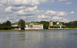 Moscow, palace Kuskovo. Moscow, palace of earl Sheremetyev Kuskovo and church on bank of lake Royalty Free Stock Images