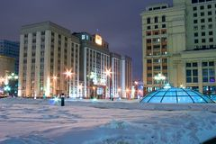 Moscow Parliament landmark. Russian historical place: Manege square (Manezhnaya ploshchad) in Moscow at a winter evening with view on the State Duma (Russian Stock Photo