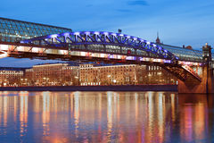 Moscow. Pedestrian bridge over the Moscow river in the evening. Stock Photos