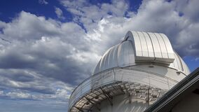 Moscow Planetarium against the moving clouds,  Russia