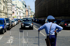 Moscow policeman on duty. Policeman watching over traffic in central Moscow Stock Photos