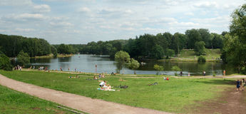 Moscow, pond in Kuzminki, people have a rest near  Royalty Free Stock Image