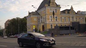 Moscow, the 3rd Syromyatnicheskiy pereulok. The traffic next to the aristocratic mansion of Prince Dolgoruky. In the basis of current lavishly decorated house stock video