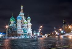 Moscow Red Square. Old ancient russian architecture: Saint Basils Cathedral at the Red Square in Moscow by a winter night illuminated by streetlight with Kremlin Stock Photo