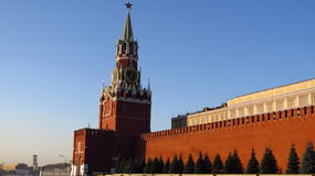 MOSCOW, RED SQUARE, SPASSKAYA TOWER. Spasskaya Tower  with kremlin walls in Red Square, Moscow, Russia Stock Photo