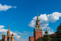 Moscow Red Square. Spassky Savior`s tower and St. Basil`s cathedral under the blue skies Royalty Free Stock Image
