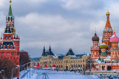 Moscow Red Square in winter. The Kremlin towers (left) skating rink on Red Square (center), St. Basil's cathedral (right). Moscow Kremlin, palaces and Royalty Free Stock Photo