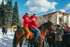 MOSCOW REGION, FRYAZINO, GREBNEVO ESTATE - MARCH 09 2019: Samy Naceri French star and actor of Taxi films and his. Brother Bibi Nacery mount a horse in front of stock photography