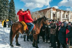 MOSCOW REGION, FRYAZINO, GREBNEVO ESTATE - MARCH 09 2019: Samy Naceri French star and actor of Taxi films and his. Brother Bibi Nacery mount a horse in front of royalty free stock images