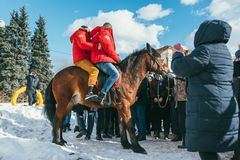 MOSCOW REGION, FRYAZINO, GREBNEVO ESTATE - MARCH 09 2019: Samy Naceri French star and actor of Taxi films and his. Brother Bibi Nacery mount a horse in front of royalty free stock photo