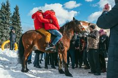 MOSCOW REGION, FRYAZINO, GREBNEVO ESTATE - MARCH 09 2019: Samy Naceri French star and actor of Taxi films and his. Brother Bibi Nacery mount a horse in front of royalty free stock image