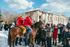 MOSCOW REGION, FRYAZINO, GREBNEVO ESTATE - MARCH 09 2019: Samy Naceri French star and actor of Taxi films and his. Brother Bibi Nacery mount a horse in front of stock photo