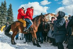 MOSCOW REGION, FRYAZINO, GREBNEVO ESTATE - MARCH 09 2019: Samy Naceri French star and actor of Taxi films and his. Brother Bibi Nacery mount a horse in front of stock images