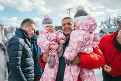MOSCOW REGION, FRYAZINO, GREBNEVO ESTATE - MARCH 09 2019: Samy Naceri French star and actor of Taxi films holds two. Children twins visiting the Grebnevo estate stock photography