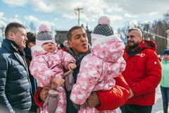 MOSCOW REGION, FRYAZINO, GREBNEVO ESTATE - MARCH 09 2019: Samy Naceri French star and actor of Taxi films holds two. Children twins visiting the Grebnevo estate royalty free stock photo