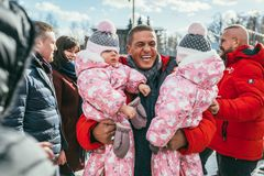 MOSCOW REGION, FRYAZINO, GREBNEVO ESTATE - MARCH 09 2019: Samy Naceri French star and actor of Taxi films holds two. Children twins visiting the Grebnevo estate royalty free stock image