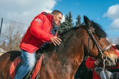 MOSCOW REGION, FRYAZINO, GREBNEVO ESTATE - MARCH 09 2019: Samy Naceri French star and actor of Taxi films mount a horse. Visiting the Grebnevo estate during royalty free stock photo