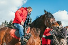 MOSCOW REGION, FRYAZINO, GREBNEVO ESTATE - MARCH 09 2019: Samy Naceri French star and actor of Taxi films mount a horse. Visiting the Grebnevo estate during stock images
