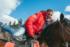 MOSCOW REGION, FRYAZINO, GREBNEVO ESTATE - MARCH 09 2019: Samy Naceri French star and actor of Taxi films mount a horse. Visiting the Grebnevo estate during stock image