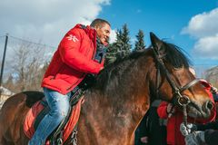 MOSCOW REGION, FRYAZINO, GREBNEVO ESTATE - MARCH 09 2019: Samy Naceri French star and actor of Taxi films mount a horse. Visiting the Grebnevo estate during royalty free stock image