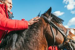 MOSCOW REGION, FRYAZINO, GREBNEVO ESTATE - MARCH 09 2019: Samy Naceri French star and actor of Taxi films mount a horse. Visiting the Grebnevo estate during stock photography