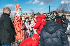 MOSCOW REGION, FRYAZINO, GREBNEVO ESTATE - MARCH 09 2019: Samy Naceri French star and actor of Taxi films piks up two. Children twins visiting the Grebnevo stock image